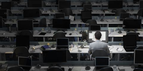 office worker alone at night