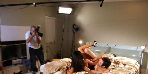 Arm, Lighting, Human body, Room, Comfort, Ceiling, Bed, Camera accessory, Black hair, Photography,