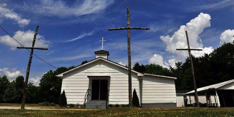 Sky, Property, Cloud, Cross, Land lot, Church, Real estate, Rural area, Symbol, Chapel,