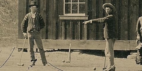 Standing, Hat, Ball game, Playing sports, Headgear, Ball, Vintage clothing, Play, Net sports, Sash window,