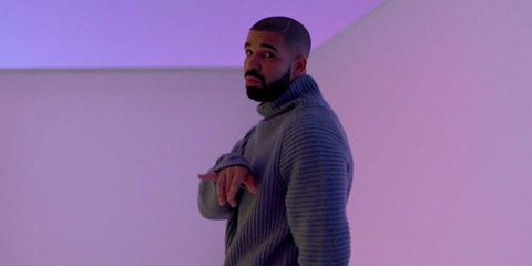Sleeve, Human body, Sweater, Cap, Standing, Elbow, Purple, Facial hair, Long-sleeved t-shirt, Sweatshirt,