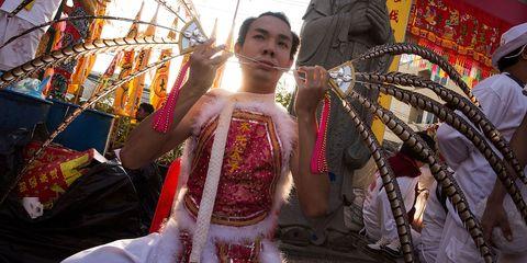 Tradition, Temple, Carnival, Festival, Baseball cap, Costume, Ritual, Fair,