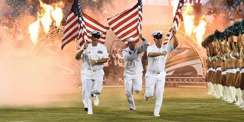 Flag, Flag of the united states, Uniform, Gesture, Team, Naval officer, Flag Day (USA), Military organization, Military person, Law enforcement,