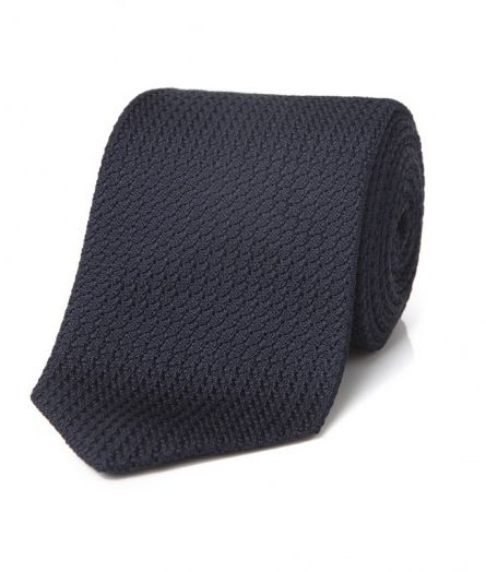 "<p>Luxuriously textured, but subtle enough to go with every suit in his wardrobe. (Seriously.)</p><p><em>Woven grenadine tie ($128) by Drake's, </em><a href=""https://www.drakes.com/grenadine-ties/dark-navy-woven-large-knot-grenadine-tie?"" target=""_blank""><em>drakes.com</em></a></p>"