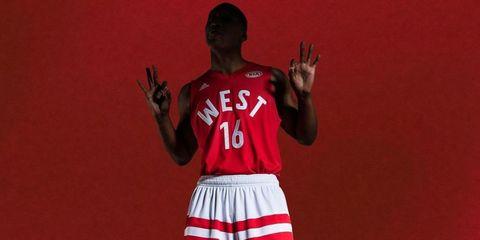 Sports uniform, Jersey, Sleeve, Human body, Sportswear, Shoulder, Standing, Red, Uniform, Sports jersey,