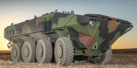 Motor vehicle, Wheel, Mode of transport, Military vehicle, Combat vehicle, Land vehicle, Fender, Auto part, Armored car, Self-propelled artillery,