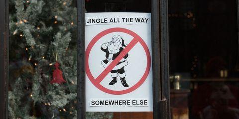 Signage, Sign, Christmas decoration, Sticker, Christmas, Conifer, Bottle, Christmas tree, Fir, Traffic sign,