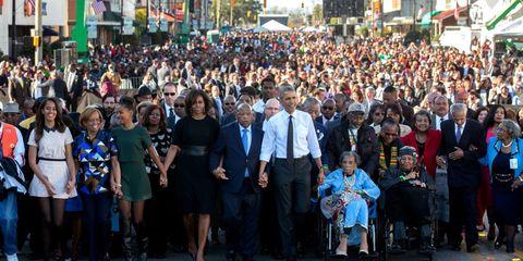 Footwear, Crowd, People, City, Public space, Urban area, Flag, Pole, Pedestrian, Audience,