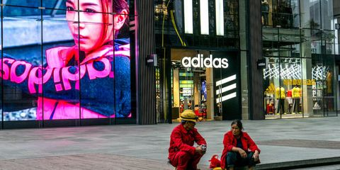 Magenta, Street, Luggage and bags, Street fashion, Advertising, Sidewalk, Baggage, Commercial building, Backpack, Street performance,