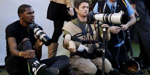 Camera, Cameras & optics, Cap, Camera operator, Team, Film camera, Lens hood, Digital camera, Camera accessory, Video camera,