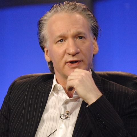 Bill Maher sitting in a chair