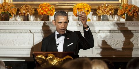 Yellow, Suit, Formal wear, Amber, Collar, Tuxedo, Floristry, Flower Arranging, Bow tie, Floral design,