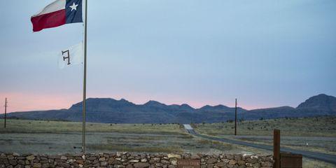 Flag, Mountainous landforms, Highland, Mountain range, Pole, Land lot, Hill, Ecoregion, Carmine, Slope,