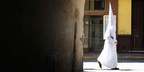 Dress, Floor, Street fashion, Concrete, Gown, Wedding dress, Plastic bag, Bridal clothing, Shadow, Sandal,