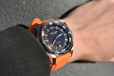 Watch, Analog watch, Wrist, Watch accessory, Fashion accessory, Font, Orange, Black, Everyday carry, Metal,