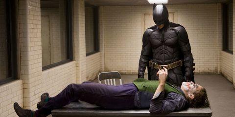 Arm, Sitting, Fictional character, Superhero, Batman, Armour, Costume, Comfort, Hero, Justice league,
