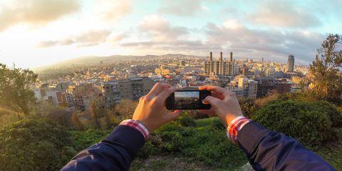 Cameras & optics, Wrist, Camera, Tower, Gadget, Digital camera, Photographer, Bracelet, Cityscape, Tower block,