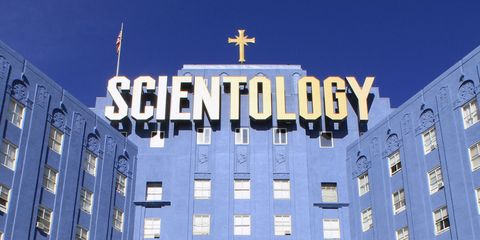 """blue building with a large sign that reads """"Scientology"""""""