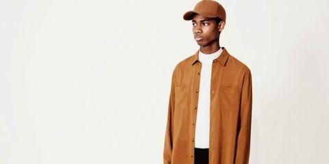 Clothing, Cap, Brown, Collar, Sleeve, Jacket, Textile, Standing, Facial hair, Dress shirt,
