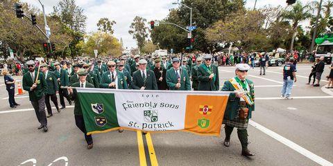 Event, Parade, Hat, Uniform, Crowd, Pole, Public event, Team, Holiday, Pedestrian,