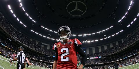 a view of the Atlanta Falcons stadium with quarterback Matt Ryan in the foreground