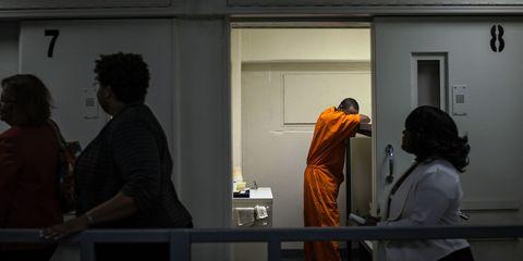 Human body, Standing, Door, Fixture, Home door, Back, Guru, Sculpture,