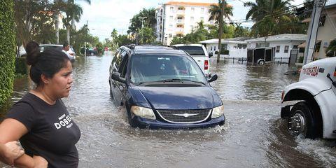 Vehicle, Land vehicle, Car, Headlamp, Flood, Travel, Hood, Mid-size car, Reflection, Grille,