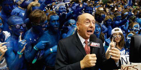 People, Event, Crowd, Audience, Suit, Fan, Public event, Electric blue, Tie, Cobalt blue,