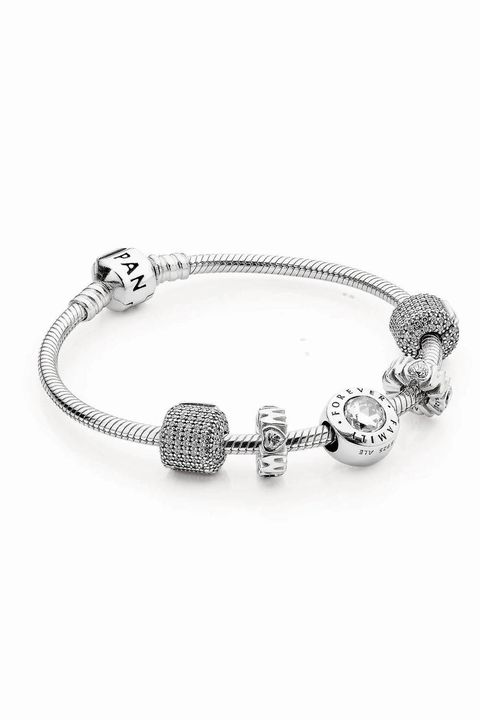 "<p>Every mom loves her family, but some moms really love to show that love off. Since she can't take her framed family photos with her wherever she goes, get her a PANDORA Family Forever Charm. That way, the world will know how much she cares. </p><p><em>Family Forever Charm ($70) *additional charms and bracelet sold separately  by PANDORA Jewelry, <a href=""http://estore-us.pandora.net/en-us/family-forever-clear-cz/791884CZ.html?cid=BrndMedia_Drop2_Apr_14_2016_Esquire_EsqGiftGuide2_FamilyForever_Charm_791884cz_PDP_Product"" target=""_blank"">PANDORA.net</a></em></p>"