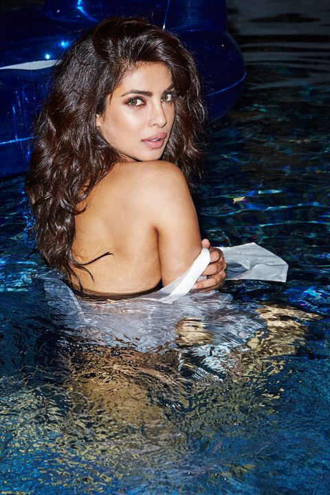 Blue, Fluid, Hairstyle, Liquid, Chest, Black hair, Beauty, Swimming pool, Muscle, Bathing,