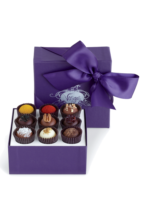 "<p>A little decadence is never a bad thing on Mother's Day, especially for a mom with a sweet tooth. Vosges Exotic Truffle Collection is the Rolls Royce of chocolates, and the perfect gift for the indulgent mom.</p><p><em>Exotic Truffle Collection, 16 pieces, ($45) by Vosges, </em><a href=""http://www.vosgeschocolate.com/product/exotic_truffles_16pc/all-chocolate-gifts"" target=""_blank""><em>vosgeschocolate.com</em></a></p>"