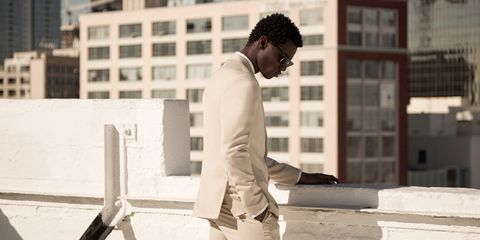 Sleeve, Standing, Collar, Blazer, Street fashion, White-collar worker, Job, Jheri curl, Pocket, Condominium,