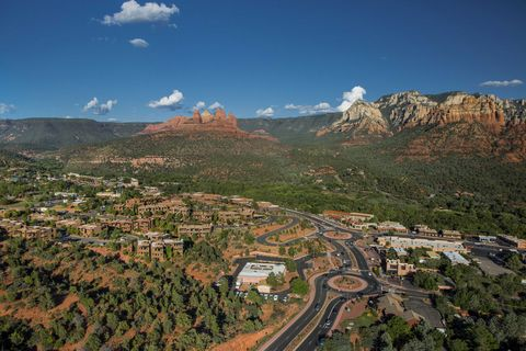 "<p>Easily one of the most beautiful locations in the Southwest, <a href=""http://visitsedona.com/"" target=""_blank"">Sedona</a> is a desert town near Flagstaff surrounded on all sides by canyons, pine forests, and red-rock buttes. Suitable for a full day of hiking, Sedona also features a slew of high-end resorts and spas, local art shops, restaurants, and the stunning architecture of the Chapel of the Holy Cross, which appears to sprout from the natural red landscape. </p>"