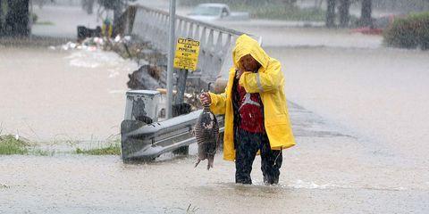 Raincoat, Rain suit, Precipitation, Rain, Puddle, Boot, Waste collector,