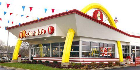 Yellow, Fast food restaurant, Real estate, Restaurant, Curb, Signage, Sidewalk, Guard rail,