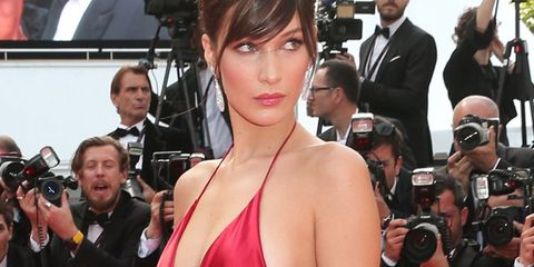 Clothing, Event, Trousers, Dress, Coat, Flooring, Red, Carpet, Premiere, Outerwear,