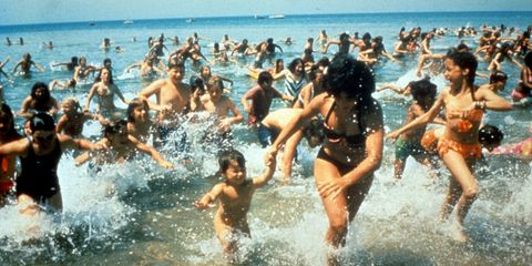 a photo from the movie Jaws shows a crowd of people running out of the ocean