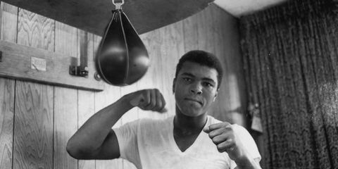 a young Muhammad Ali punches a punching bag