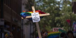 "a cross that reads ""in memory of pulse night club victims"""