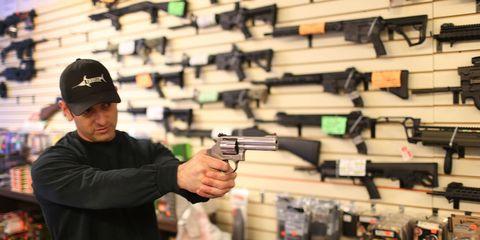 Cap, Gun, Firearm, Shooting, Baseball cap, Air gun, Trigger, Gun accessory, Shotgun, Ammunition,