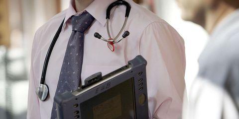 Dress shirt, Collar, Sleeve, Display device, Tie, Gadget, Button, Fashion design, Pocket, Multimedia,