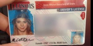 a drivers license with a photo of a woman wearing a steel colander on her head