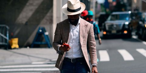 Hat, Trousers, Coat, Shirt, Textile, Outerwear, Standing, Style, Street fashion, Suit,
