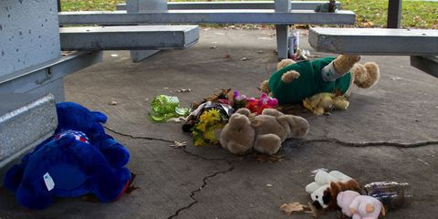 teddy bears on cracked concrete between picnic tables