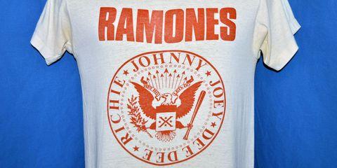 Sleeve, Textile, Symbol, Emblem, Bird, Electric blue, Accipitridae, Active shirt, Accipitriformes, Bird of prey,