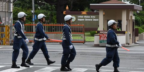 Helmet, Road surface, Workwear, Uniform, Personal protective equipment, Headgear, Asphalt, Hard hat, Pedestrian, Law enforcement,