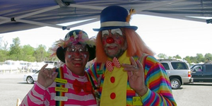 Two clowns smiling at the camera