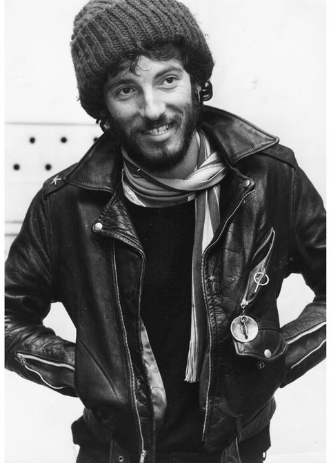 Clothing, Jacket, Sleeve, Textile, Standing, Outerwear, Facial hair, Style, Monochrome, Leather,
