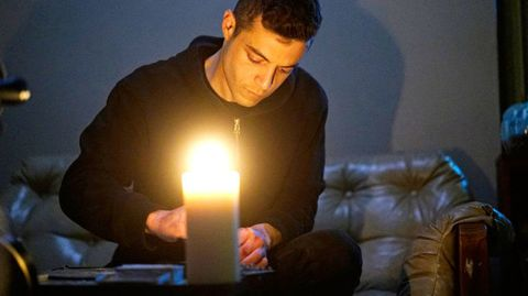 Lighting, Sitting, Light, Flame, Couch, Candle, Black hair, Comfort, Fire, Heat,