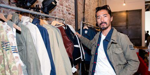 Textile, Jacket, Clothes hanger, Beard, Dress shirt, Facial hair, Cap, Street fashion, Video camera, Goggles,